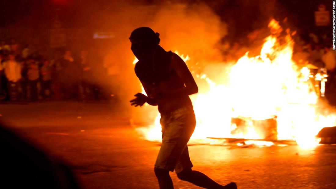 Anger in the teenager's community erupted after the shooting. In the following two days, protesters torched cars, damaged ambulances and burned tires as the violence spread across the country.